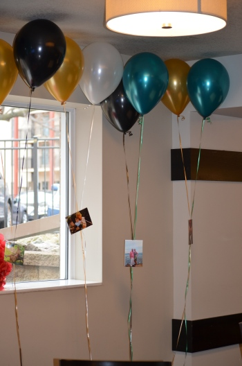 Helium balloons with photos of the bride/groom