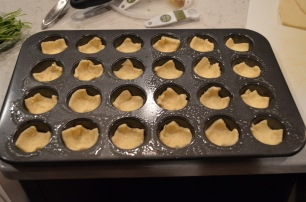 spray a mini muffin pan well then use crescent squares to create little bowls.