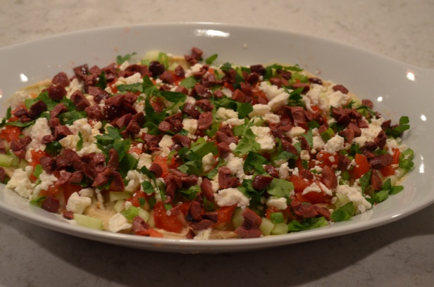 then top with the olives, feta, tomatoes, etc!