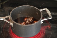 Simmering the dates in wine and honey